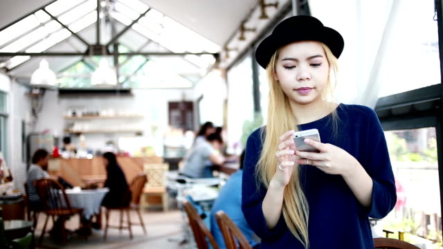 Woman play smartphone at coffee shop cafe