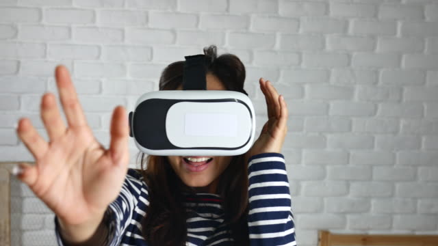 Woman playful Virtual Reality Headset at Home