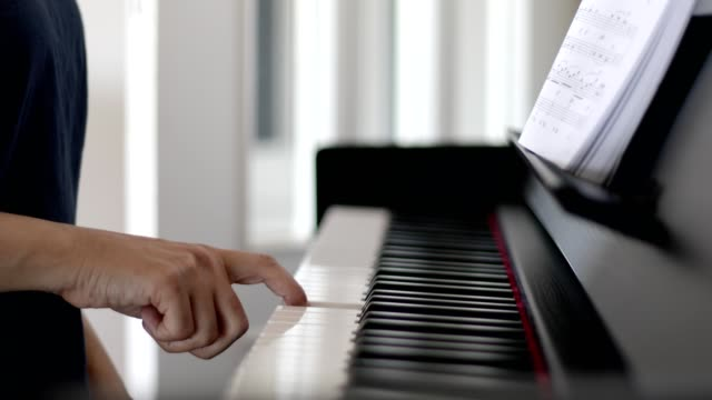 woman playing a piano - index finger stock videos & royalty-free footage