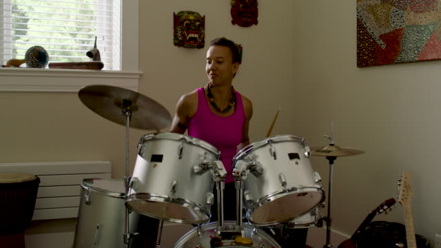 woman playing and practicing drums at home - drummer stock videos & royalty-free footage