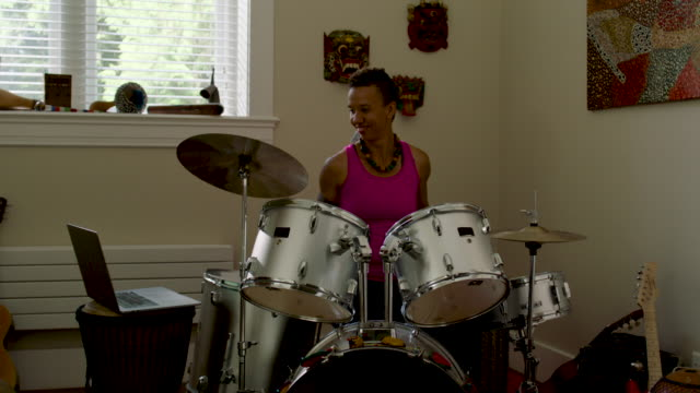 woman playing and practicing drums at home - drum percussion instrument stock videos & royalty-free footage