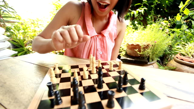 woman playing chess - chess stock videos & royalty-free footage