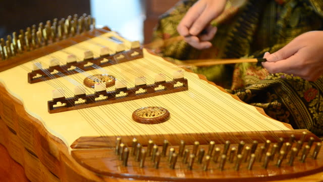 woman playing chinese dulcimer - mallet hand tool stock videos and b-roll footage