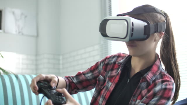 Woman playing Game with VR Glasses