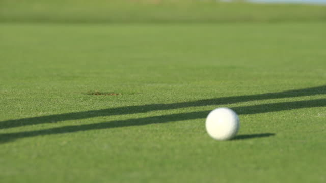 a woman playing golf. - slow motion - golf shoe stock videos and b-roll footage