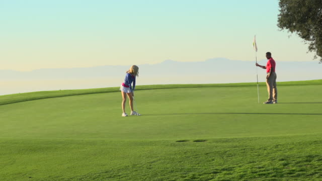 A woman playing golf. - Slow Motion