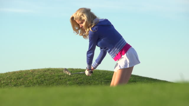 a woman playing golf. - super slow motion - filmed at 240 fps - golf course stock videos & royalty-free footage