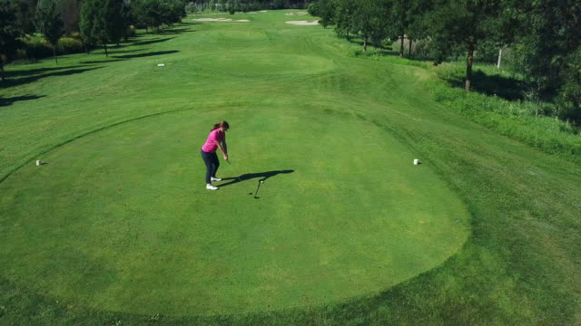 woman playing golf - wide shot stock videos & royalty-free footage