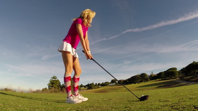 A woman playing golf.