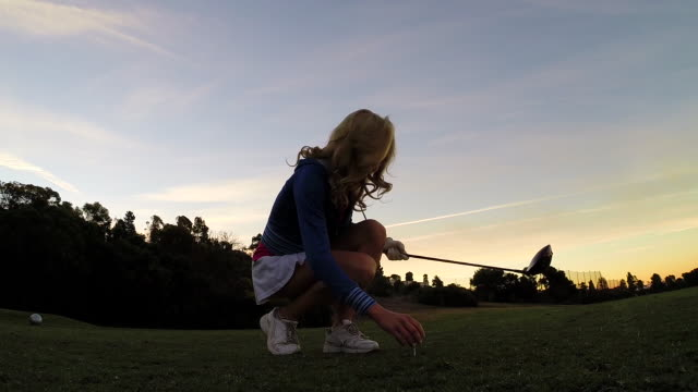 a woman playing golf. - golf swing women stock videos & royalty-free footage