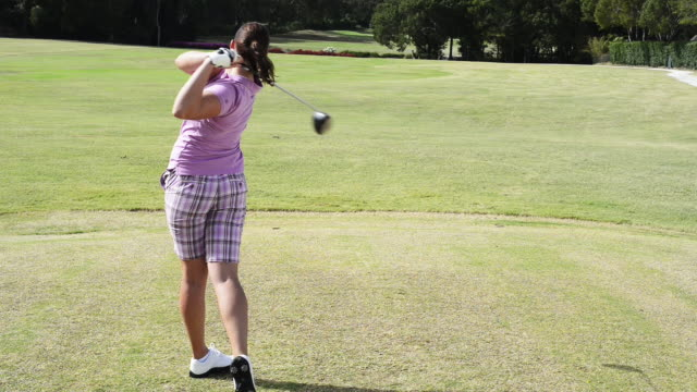 woman playing golf - golf shoe stock videos & royalty-free footage