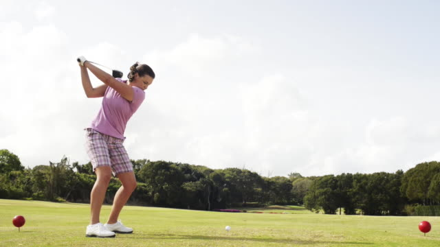 woman playing golf - golf glove stock videos and b-roll footage