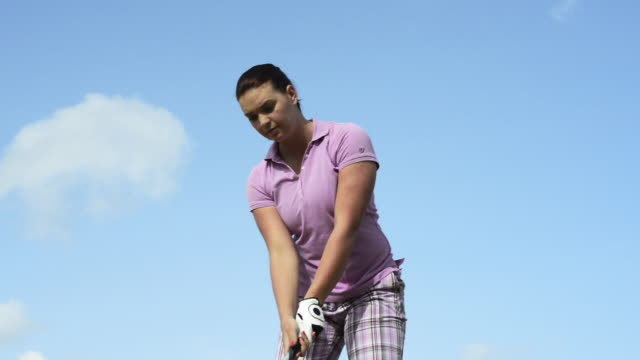 woman playing golf - polo shirt stock videos & royalty-free footage