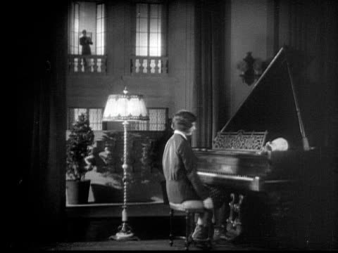 MS, CU, B&W, Woman playing grand piano, male admirer clapping, 1920's