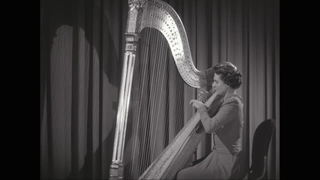 ms zi woman playing harp on stage / united states - harp stock videos & royalty-free footage