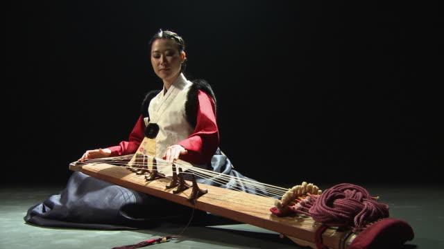 ms zi woman playing kayakum / seoul, south korea / audio - classical stock videos & royalty-free footage