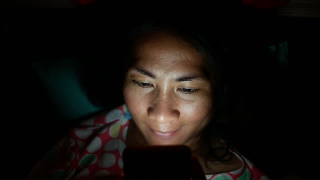 woman playing mobile phone in bedroom - e mail stock videos & royalty-free footage