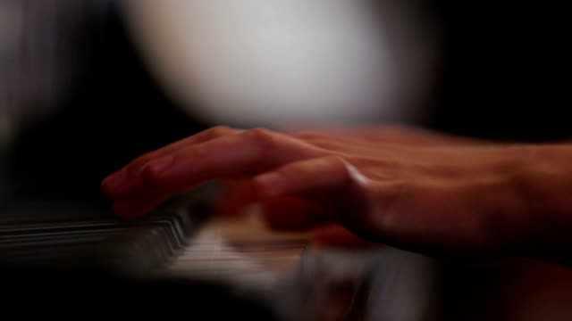 Woman playing piano close up shoot