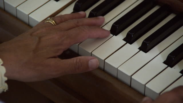 cu ha pan woman playing piano, close-up of hands / seattle, washington state, usa - piano key stock videos & royalty-free footage