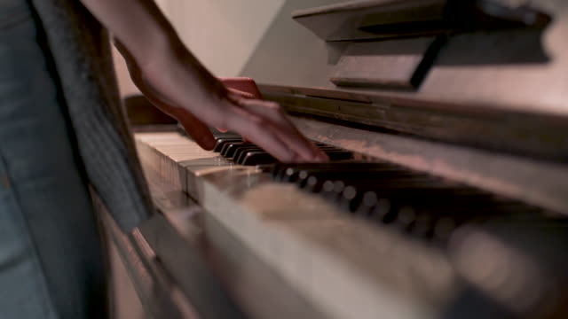 woman playing piano - human finger stock videos and b-roll footage
