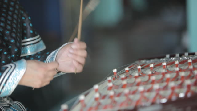 woman playing string instrument called yoochin - string instrument stock videos and b-roll footage