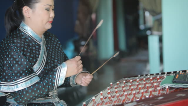woman playing string instrument called yoochin - string instrument stock videos & royalty-free footage