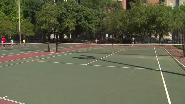 woman playing tennis on august 15, 2013 in chicago, illinois - tennis racquet stock videos & royalty-free footage