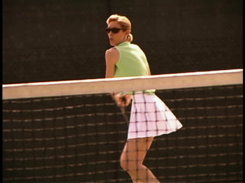 woman playing tennis - three quarter length stock videos & royalty-free footage