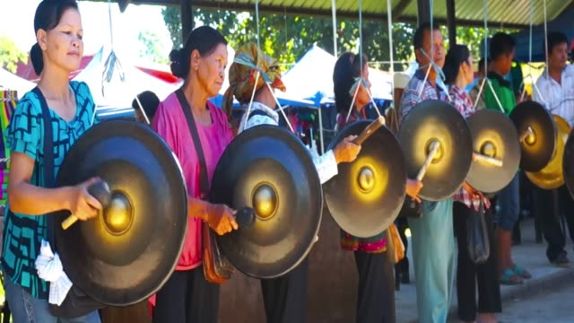 woman playing the gong with a mallet - folk music stock videos and b-roll footage
