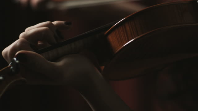 woman playing the violin - orchestra stock videos & royalty-free footage