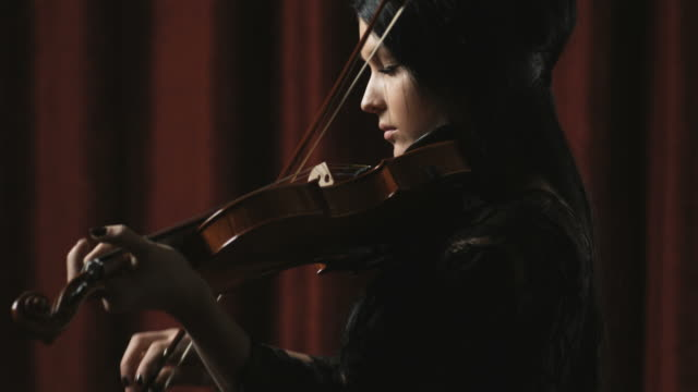 woman playing the violin - violin stock videos & royalty-free footage