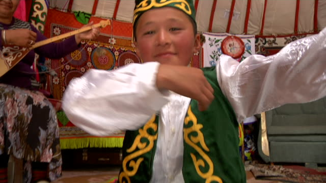 woman playing two stringed instrument called topshur and boy dancing - stringed instrument stock videos & royalty-free footage