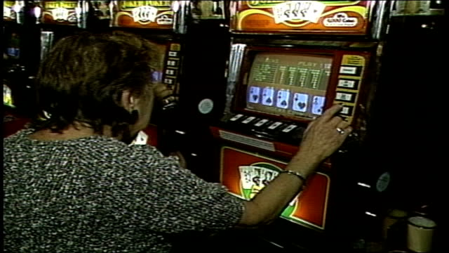 woman playing video poker - atlantic city stock videos & royalty-free footage