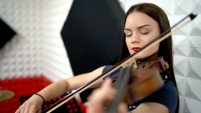 woman playing violin in recording studio - drum kit stock videos & royalty-free footage