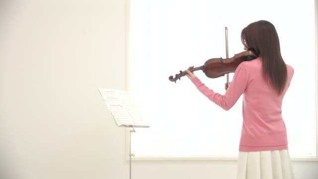woman playing violin - violin stock videos & royalty-free footage