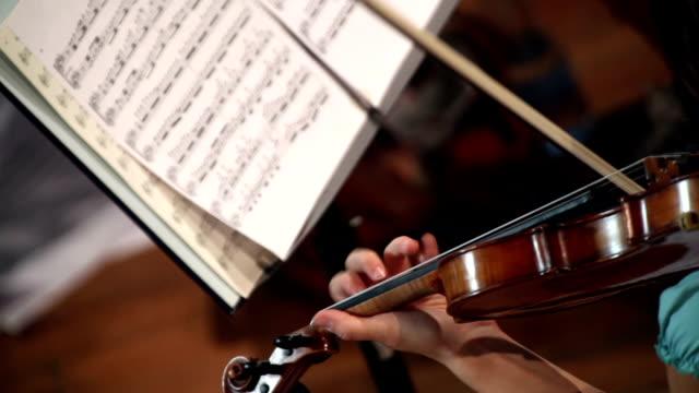 woman playing violin - sheet music stock videos & royalty-free footage