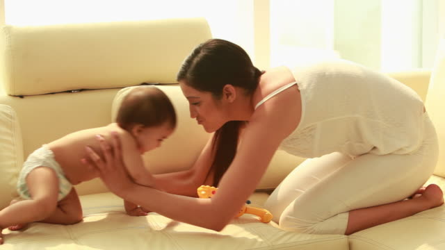 woman playing with her baby  - crawling stock videos & royalty-free footage
