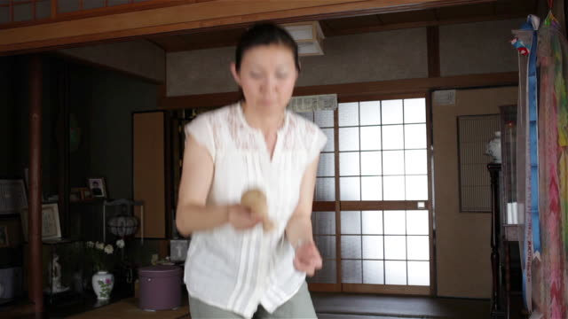 woman playing with kendama - only mature women stock videos & royalty-free footage