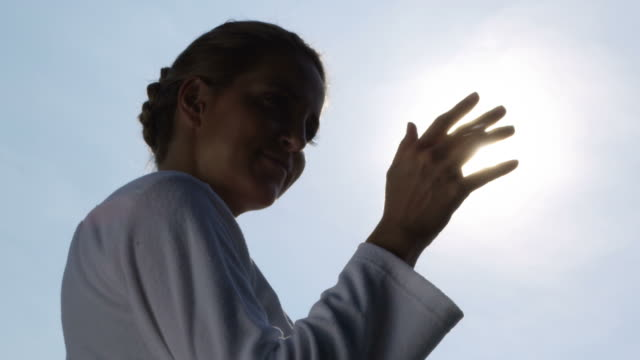 Woman playing with the sun