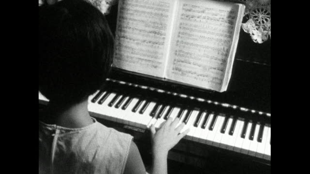 woman plays a piano at home; 1966 - piano key stock videos & royalty-free footage