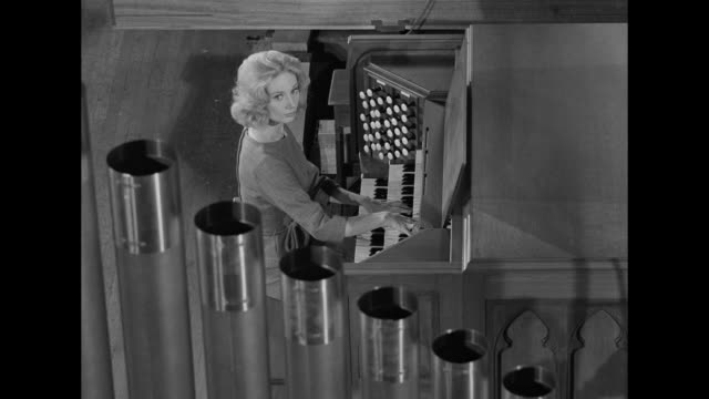 1962 A woman plays a pipe organ