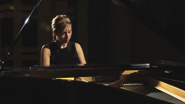 hd: woman plays the piano - piano stock videos and b-roll footage