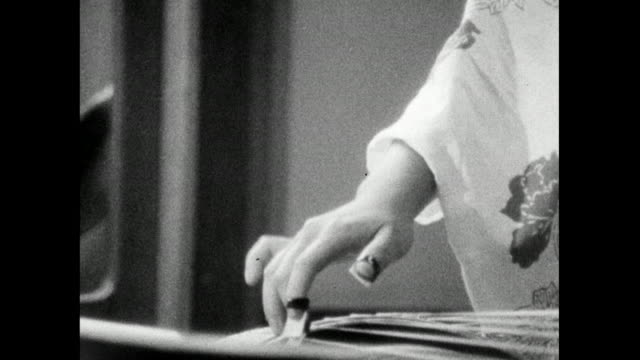 woman plays traditional japanese koto harp; 1966 - bbc archive stock-videos und b-roll-filmmaterial