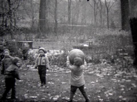 1929 woman plays with large ball with kids - preschool stock videos and b-roll footage