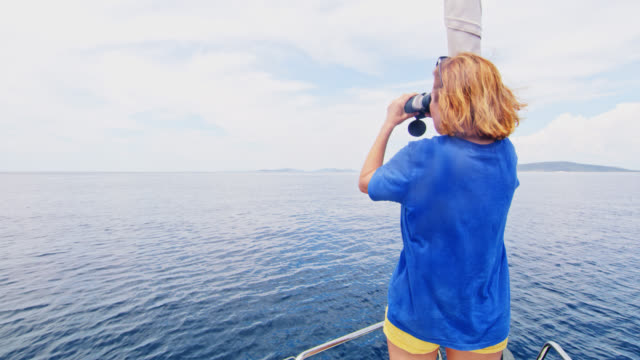 WS Woman pointing at island in the distance