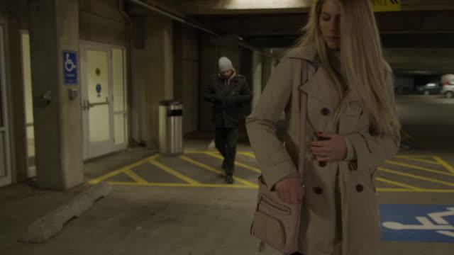 woman pointing gun at man following her in parking garage / provo, utah, united states - provo stock videos & royalty-free footage
