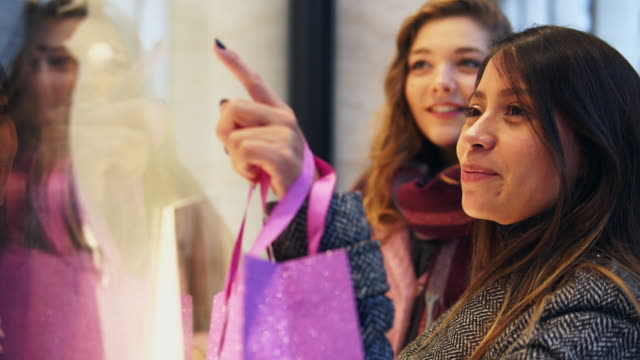 woman pointing to clothes in a store window. - girlfriend stock videos & royalty-free footage