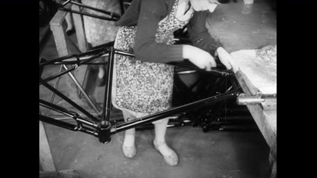 woman polishes and cleans a bicycle frame in factory; 1952 - 1952 stock videos & royalty-free footage