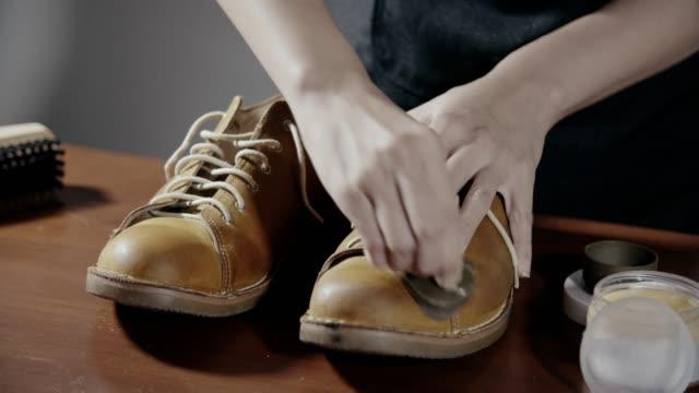 woman polishing tan leather brogues - polishing stock videos & royalty-free footage
