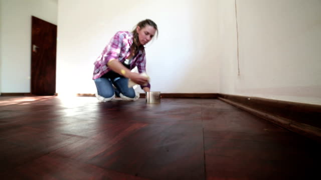 woman polishing wooden floor - polishing stock videos & royalty-free footage